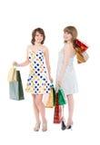 Dwa szczęśliwego przyjaciela z zakupami. Fotografia Stock