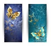 Dwa sztandaru z złocistymi motylami Zdjęcia Royalty Free