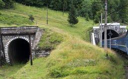 Dwa tunelu w Carpathians z wchodzić do pociągiem zdjęcia stock