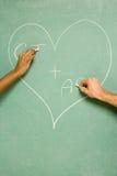 Dwa ucznia rysuje na blackboard Zdjęcie Royalty Free