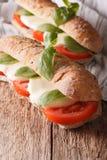 Dwa Włoska kanapka z pomidorów, mozzarelli i basilu zakończeniem, zdjęcie stock