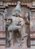 Dwarapalaka statue on Gopuram of Brihadeswarar temple. Royalty Free Stock Photo