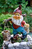 Dwarf. Happy to help in the garden, with two baskets Royalty Free Stock Photos