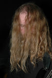 Dwarf bass player 3. Long haired bass player Royalty Free Stock Image