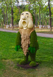 Dwarf in the fairy tale about Snow White. Park skulptura- dwarf from the fairy tale about Snow White made from plants Royalty Free Stock Photography