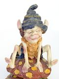 Dwarf fantasy figure. Smiling dwarf from fantasy. Gnome royalty free stock photo