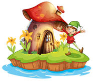 A dwarf outside a mushroom house Royalty Free Stock Photo