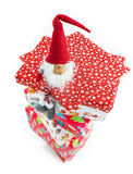 Dwarf on top of Christmas present boxes Royalty Free Stock Images