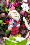 Dwarf under the tree. Pear tree decorated, decorations, with the rewards pink gnome Royalty Free Stock Image