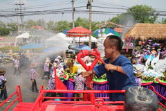 Dwarf water from fire trucks. PHIcHIT THAILAND-APRIL 17 Royalty Free Stock Photo