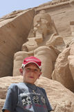 Dwarfed by the statue. One teen tourist in front of Abu Simbel temples, Egypt,Africa Stock Image