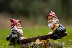 Dwarfs. Toy of dwarfs playing with seesaw in the grass Royalty Free Stock Images