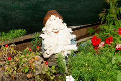 Dwarfs decorate the garden near the house. Sculptures fabulous dwarves. Royalty Free Stock Photos