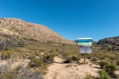 Information board on the trail to the Maltese Cross. DWARSRIVIER, SOUTH AFRICA, AUGUST 23, 2018: An information board on the Bokveldskloof Trail to the Maltese royalty free stock image