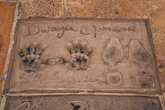 Dwayne feet and hands prints. At the TCL Chinese Theatre in Hollywood Stock Images