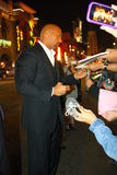 Dwayne Johnson. Dwayne signs autographs in Hollwood Stock Photography