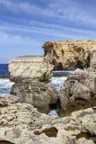 Dwejra Bay, a year after the collapse of Azure Window, San Lawrenz Gozo Malta. Dwejra Bay with Dwejra Point, a year after the collapse of Azure Window, San Royalty Free Stock Photos
