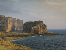 Dwejra coast, Gozo island, Malta. Rocks in the sunset light at the Dwejra coast of Gozo island, Malta Royalty Free Stock Photography