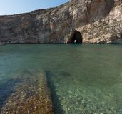 Dwejra Inland Sea on the island of Gozo. Dwejra Inland Sea island of Gozo, Malta with a cave connecting lagoon with the sea Stock Photo