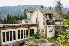Dwelling building in the mountain woods Royalty Free Stock Image