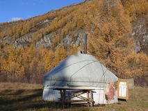 Dwelling of cattlemen. Picture of dwelling of nomads on a background of mountain with an autumn wood Stock Image