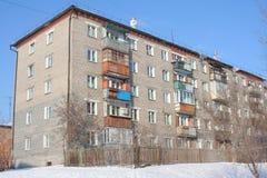 Dwelling five floors. Brick dwelling in five floors on background blue sky in winter Royalty Free Stock Image