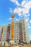 Dwelling house and tower crane on the construction site Stock Photo