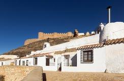 Dwelling  houses built into mount. Chinchilla Stock Photo