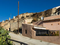Dwelling  houses built into rock Royalty Free Stock Photography