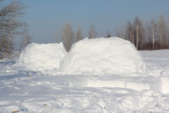 The dwelling an igloo   on a snow glade Royalty Free Stock Image