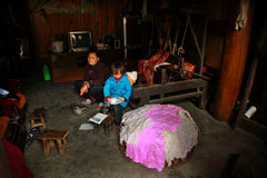 Dwelling Interior Asian peasant farmers, Chinese woman with a ch Royalty Free Stock Photos