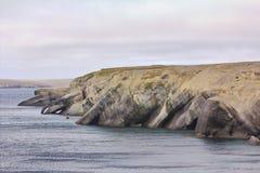 Dwelling nymphs and Proteus: bizarre rocky coast of Novaya Zemlya archipelago, Barents sea. Royalty Free Stock Photography