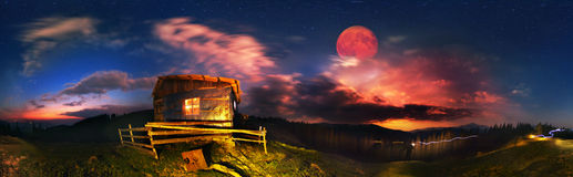 Dwelling shepherds at night. Carpathian landscape at night, on a deserted pasture. The rising moon illuminates the space of the mountains, where shepherds soon Stock Images