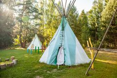 Dwelling tipi, The wigwam in the forest.  royalty free stock photography