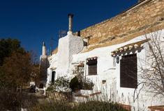 Dwellings  aves built  into mount.  Chinchilla de Monte-Aragon Royalty Free Stock Images