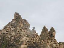 Dwellings in the rocks of volcanic tuff in Cappadocia, central Turkey stock image