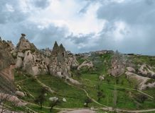 Dwellings in the rocks of volcanic tuff in Turkish Cappadocia. Panorama of Goreme National Park stock images