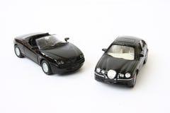 dwie czarne auta Zdjęcia Royalty Free