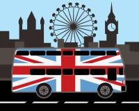 Dwoistego decker autobus w wielkim Britain flaga kolorze Zdjęcie Stock