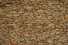 Dy stone wall. Seamless background of dry stone or brick wall Royalty Free Stock Photography