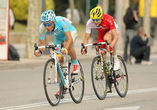 Dyachenko of Astana and Molard of Cofidis. Alexsandr Dyachenko(L) of Astana and Rudy Molard(R) of Cofidis rides during the Tour of Catalonia cycling race through Stock Images