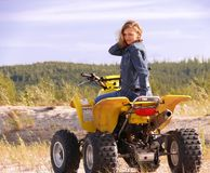 Dyakova Helen on quadrocycle. Royalty Free Stock Photo