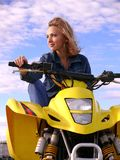 Dyakova Helen on quadrocycle. Royalty Free Stock Photos
