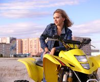 Dyakova Helen on quadrocycle. Royalty Free Stock Images