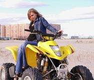 Dyakova Helen on quadrocycle. Royalty Free Stock Image