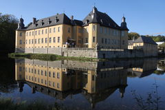 Dyck Castle. In Germany on a clear day with a view of the façade, walls, towers and a reflection of the building in the moat stock image