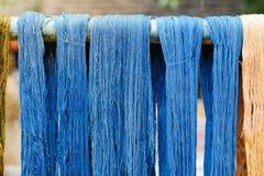 Dye thread. Blue indigo dye silk thread stock photo