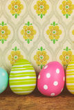 Dyed big easter eggs on a wooden table royalty free stock image