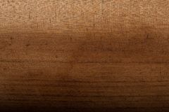 Dyed brown wood for background. Dyed, brown, and smoothly finished wood for background or wallpaper. Uneven shade of brown on the wood stock photography