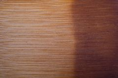 Dyed brown wood for background. Dyed, brown, and smoothly finished wood for background or wallpaper. Uneven shade of brown on the wood stock photos